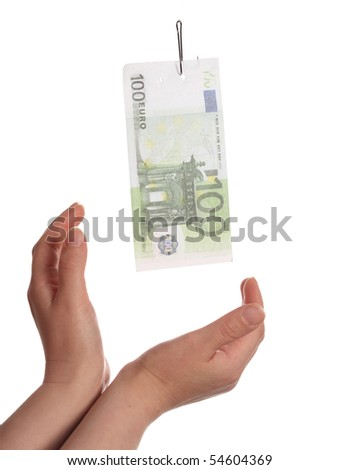 Human hands catching fake banknote on fishing hook