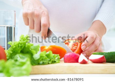 Human hands  cooking vegetables salad in kitchen
