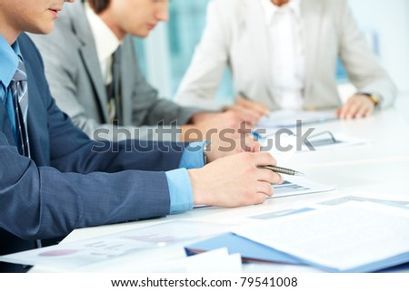 Human hands during paperwork in office