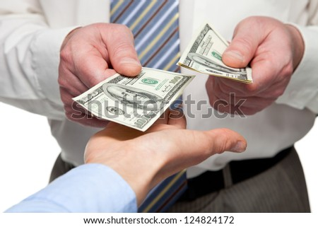 Human hands exchanging money - closeup shot