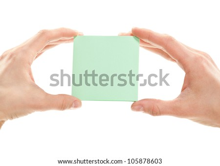 Human hands holding blank sticker/note/paper - you can add your text on it, isolated on white