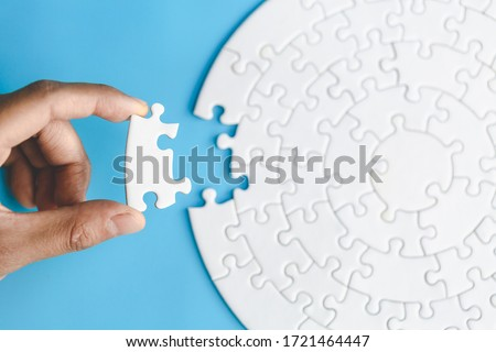 Human hands holding jigsaw  with word problem & solution.  symbol of association and connection. business strategy.