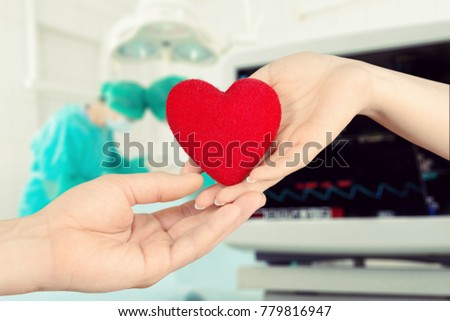 Human hands holding red heart #779816947