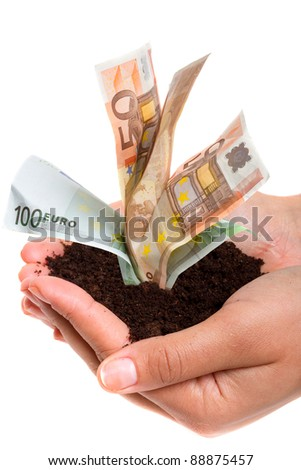 Human hands holding soil with growing money