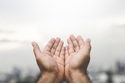 Human hands open palm up worship Praying hands with faith and belief in God of an appeal to the sky. Concept Religion and spirituality with believe Power of hope or love and devotion.