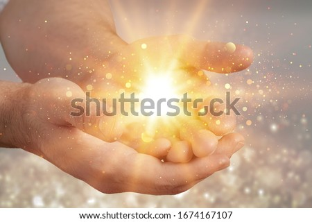 Human hands praying for blessing with lights shining Stockfoto ©