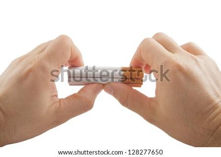 Human hands preparing to break stack of cigarettes Anti smoking concept