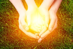 Human hands show the symbol of prayer or blessings light