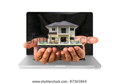 human hands showing house on laptop