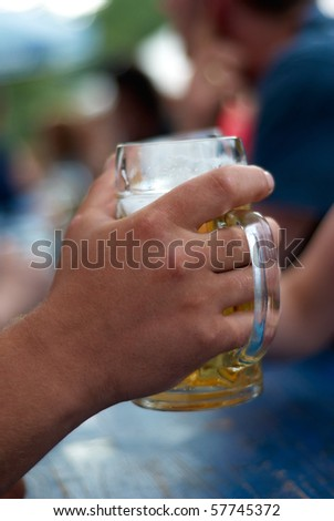 human hands toast with two glasses of beer