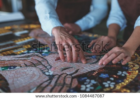 Human hands with mosaic in workshop #1084487087