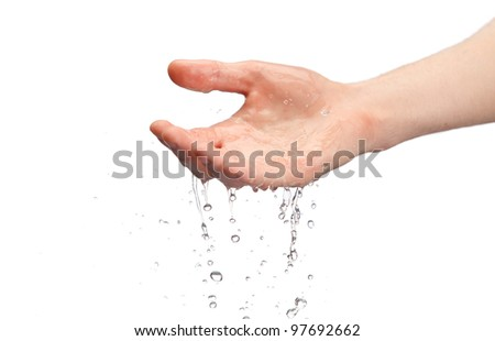 human hands with water splashing on them - stock photo