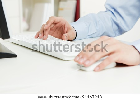 Human hands working on the computer