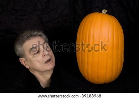 Human head and a pumpkin.