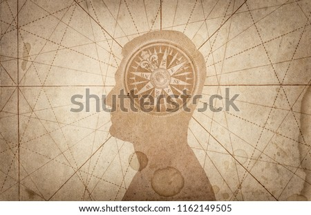 Human head and compass. The concept on the topic of navigation, psychology, morality, etc. ストックフォト ©