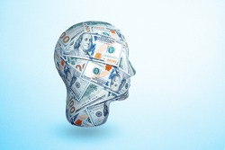 human head made by 100 dollar banknotes. Idea to earn money. The concept of money addiction, working only for money, business, startup, career.
