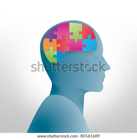 Human head silhouette with brain shaped puzzle