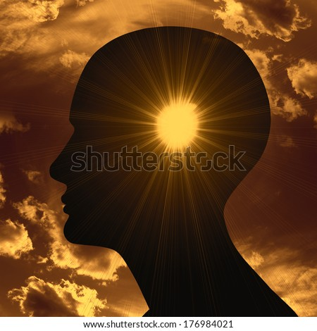 human head with light and sun clouds background