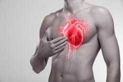 Human heart, man holding his hand in the area of chest