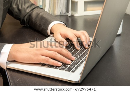 human officer sit on chair use hand typewriter doing work send email or play game and comment  on laptop #692995471