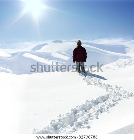 Human on mountain, winter, snow, walk - stock photo