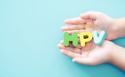 Human papilloma virus or HPV.HPV word on woman hands.Cancer.transmitted disease.Skin to skin contact.pap smear.Women's health concept.pap smear test.vaccine.Medical healthcare.world cancer day.