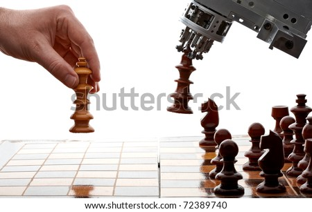 human playing chess with a machine