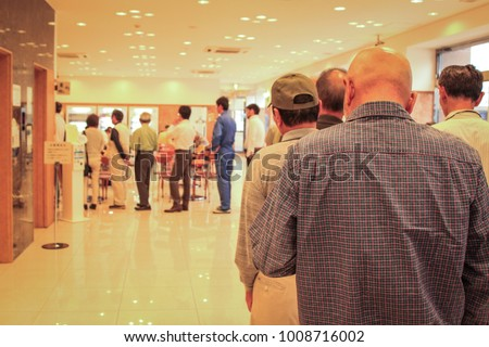 Human queue in line store
