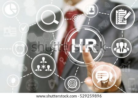 Human resource business concept. HR word button. Businessman presses hr icon on virtual screen on background of network business success sign.