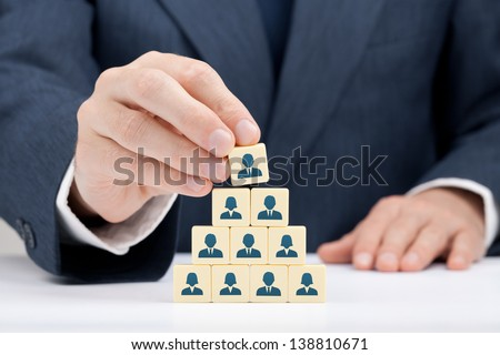 Human resources and corporate hierarchy concept - recruiter complete team by one leader person (successor, CEO) represented by icon.