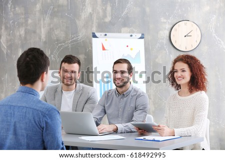 Human resources commission interviewing man in office #618492995