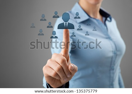 Human resources, CRM and social networking concept - female officer choose person (employee, successor) represented by icon.