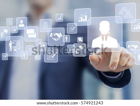 Human resources (HR) management concept on a virtual screen interface with a business person in background and icons about recruiting, technology, data, training