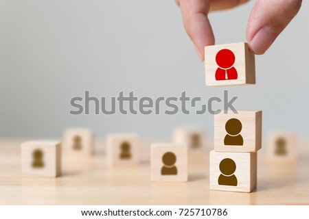 Human resources management and recruitment business build team concept, Hand putting wood cube block on top, Copy space