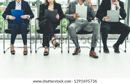 Human resources management concept - Business man and business woman sitting in office waiting for interview with the human resource manager. #1291695736