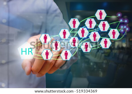 Human resources management concept, business man pressing HR icon on virtual screen.