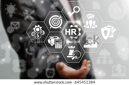Human resources services business concept. Businessman offers hr cogwheel icon on virtual screen. Recruitment service.