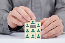Human resources, social networking and sales force team concept - recruiter complete team by one person (employee) represented by icon.