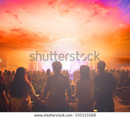 Human rights concept: Silhouette many people raised hands over sunset background.