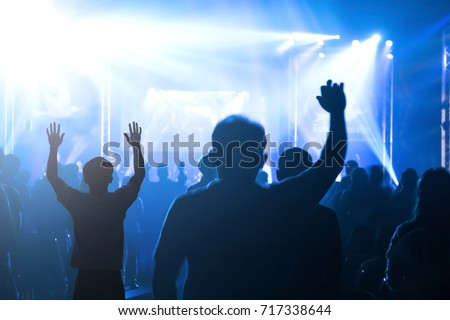 Human rights concept: Silhouette many people raised hands over sunset background.  #717338644