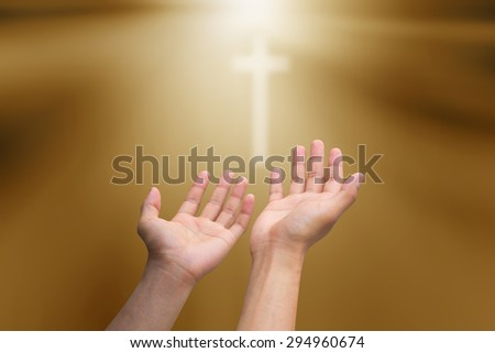 human\'s hands praying cross on blurred twilight sky background : hand open receiving power from god. religion concept.