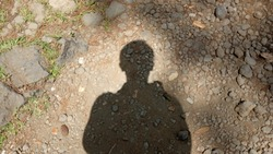 human shadow on the ground