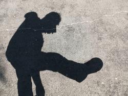 Human shadow on the ground.