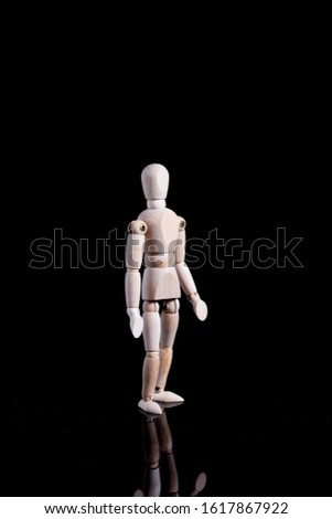 Human shape wooden mannequin. The mannequin allows for movement and therefore can be placed in different poses/raapositions.