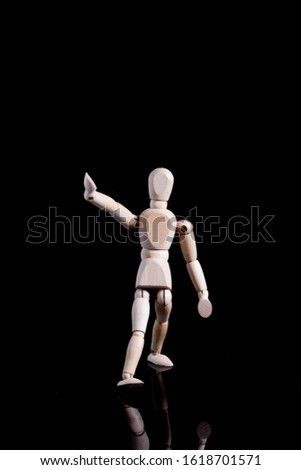 Human shape wooden mannequin. The mannequin allows for movement and therefore can be placed in different poses/ positions.