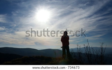 Human silhouette and Sun.