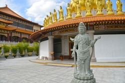 """Human Size Guanyin Stone Statue at Fo Guang Shan Thaihua Temple a Beautiful Mahayana Buddhist Taiwanese Temple Locates in North Bangkok Thailand (the non-English text is """"the temple is round"""")"""