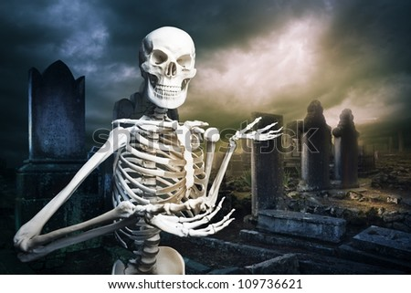 human skeleton in a graveyard at Halloween