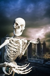 human skeleton in a graveyard on Halloween