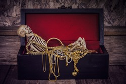 Human Skeleton keeping watch his gold and Valuable thing,Still life ,Retro dark style